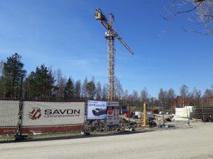 Asunto Oy Iisalmen Virrantähden perustuksia rakentamassa